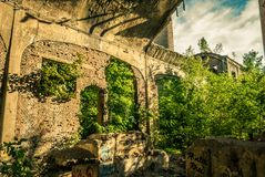 The ruins of the factory. The ruins of the old cement plant Stock Photos