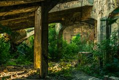 The ruins of the factory. The ruins of the old cement plant royalty free stock photos
