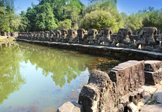 Ruins of a fencing of a sacred reservoir when approaching to the temple Neak Pean near Siem Reap, Cambodia Stock Photography