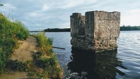 Bay of the Volkhov River, with ruins of a tower royalty free stock photography
