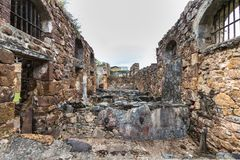Abandoned Prison in Salvation`s Islands, French Guiana. Ruins of former penal colony at Ile Royale, one of the islands of Iles du Salut Islands of Salvation in Stock Photo