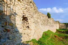Ruins of fortification bulwark. Medieval rampart Stock Photo