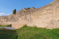 Ruins of fortification bulwark. Medieval rampart Stock Images