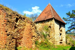 Ruins. Fortified medieval saxon evangelic church in the village Felmer, Felmern, Transylvania, Romania. The settlement was founded by the Saxon colonists in the Stock Photos