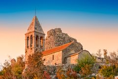 Ruins of fortress Čačvina and church All the Saints. Near town of Trilj in Dalmatian Zagora. Tower and church are placed on the hill overlooking the town and Stock Images