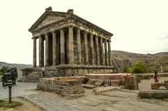 The ruins of the fortress overlooking the restored medieval pagan temple, built in honor of the Sun God Mithra in the village of G. Garni, Armenia, October 20 stock images