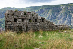 The ruins of the fortress wall. Remains of fortifications in Kotor (Montenegro Royalty Free Stock Photography