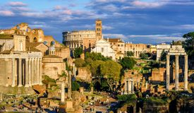 Ruins of Forum Romanum and Colosseum, Rome, Italy. Ruins of ancient Forum Romanum, the center of the antique Roman Empire, and the Colosseum in Rome, Italy Stock Images