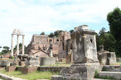 Ruins of Forum Romanum. With marble columns of Il Tempio dei Dioscuri and Roman temples in Rome, Italy Stock Photography