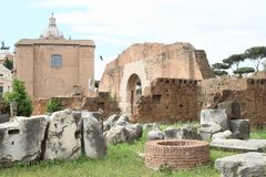 Ruins of Forum Romanum. With dwell and Curia lulia behind in Rome, Italy Royalty Free Stock Image