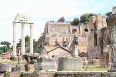 Ruins of Forum Romanum. With marble columns of Il Tempio dei Dioscuri and Roman temples in Rome, Italy Stock Images