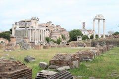 Ruins of Forum Romanum. With marble columns of Il Tempio dei Dioscuri and Tempio di Antonino e Faustina in Rome, Italy Stock Photos