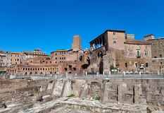 Ruins of a forum of Trajan.Cityscape in a sunny day Stock Photos