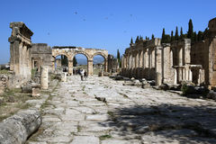 The ruins of Frontinus Street looking towards the Arch of Domitian in the ancient city of Hierapolis at Pamukkale in Turkey. Stock Photos