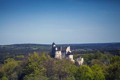 Ruins of a Gothic castle in Bobolice, Poland. Castle in the vill Royalty Free Stock Photography