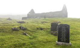 Ruins and graveyard of Cill chriosd on Isle of Skye in mist Royalty Free Stock Photography