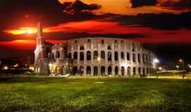 Colosseum at sunset Stock Images