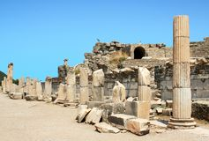 Ruins of greek city Ephesus. Antiquity greek city- Ephesus. Columns and blue sky Royalty Free Stock Photos