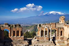 Ruins of the Greek Roman Theater, Taormina, Sicily, Italy. Ruins of the Greek Roman Theater with Etna erupting, Taormina, Sicily, Italy royalty free stock image