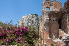 Ruins of Teatro di Taormina, Sicily, Italy. Ruins of the greek roman theater of Taormina, Sicily, Italy on a hot summer day Stock Images