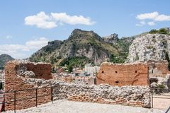 Ruins of Teatro di Taormina, Sicily, Italy. Ruins of the greek roman theater of Taormina, Sicily, Italy on a hot summer day Royalty Free Stock Images