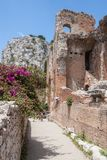 Ruins of Teatro di Taormina, Sicily, Italy. Ruins of the greek roman theater of Taormina, Sicily, Italy on a hot summer day Stock Photo