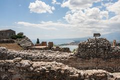 Ruins of Teatro di Taormina, Sicily, Italy. Ruins of the greek roman theater of Taormina, Sicily, Italy on a hot summer day Royalty Free Stock Photo