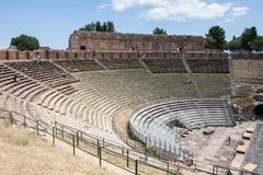 Teatro di Taormina, Sicily, Italy. Ruins of the greek roman theater of Taormina, Sicily, Italy on a hot summer day Royalty Free Stock Images