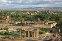 Ruins of Hampi. India. Hampi is an ancient village in the south Indian state of Karnataka. It's dotted with numerous ruined temple complexes from the Stock Photo