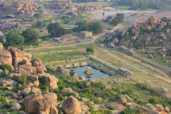 Ruins of Hampi, India. Hampi, the former capital of Vijayanagara Empire, whose powerful ruler,Sri Krishnadevaraya is very known in Indian history is located in Stock Image