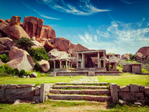 Ruins in Hampi. Vintage retro effect filtered hipster style image of tourist indian landmark Ancient ruins in Hampi. Hampi Bazaar, Hampi, Karnataka, India Stock Photo