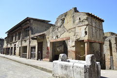 Ruins at Herculaneum. A remarkably well preserved street in Herculaneum, a town which was covered for in ash and mud for centuries royalty free stock image
