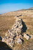 Ruins of Hierapolis. Ruined stone wall in archeological site of ancient historical Hierapolis in Turkey, very is popular travel destionation for tourists Stock Image