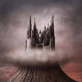 Ruins on the hill. A poster in the style of gothic and fantasy. The ruins of the castle on the hill, surrounded by a cloud. Computer graphics Royalty Free Stock Photo