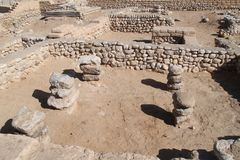 Ancient Tel Beer Sheva, Israel. Ruins of historic house building made of stones and columns at the Archeological National park Tel Beer Sheva, Israel royalty free stock photos