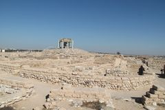 Ancient Tel Beer Sheva, Israel. Ruins of historic houses buildings made of stones and columns at the Archeological National park Tel Beer Sheva, Israel royalty free stock image