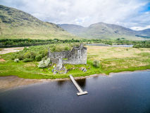 The ruins of historic Kilchurn Castle and jetty on Loch Awe Royalty Free Stock Photos