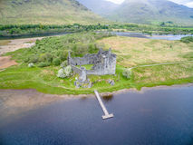 The ruins of historic Kilchurn Castle and jetty on Loch Awe Royalty Free Stock Photography