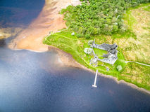 The ruins of historic Kilchurn Castle and jetty on Loch Awe Stock Image
