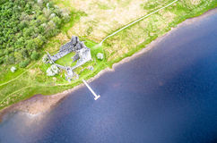 The ruins of historic Kilchurn Castle and jetty on Loch Awe Royalty Free Stock Image