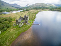 The ruins of historic Kilchurn Castle and jetty on Loch Awe Stock Photography