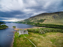 The ruins of historic Kilchurn Castle and jetty on Loch Awe Stock Photos