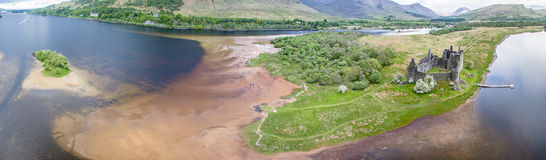 The ruins of historic Kilchurn Castle and jetty on Loch Awe Royalty Free Stock Images