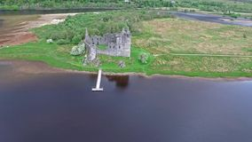 The ruins of historic Kilchurn Castle and jetty on Loch Awe. Argyll, Scotland stock footage