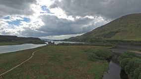 The ruins of historic Kilchurn Castle and jetty on Loch Awe. Argyll, Scotland stock video