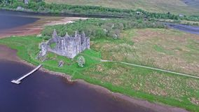 The ruins of historic Kilchurn Castle and jetty on Loch Awe. Argyll, Scotland stock video footage