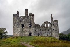 The ruins of historic Kilchurn Castle and view on Loch Awe. On a cloudy autumn day Stock Photos