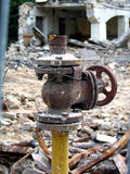 Ruins of house. With big valve in front Stock Images