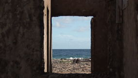 Ruins of house on Bonaire stock video footage