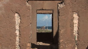 Ruins of house on Bonaire stock footage